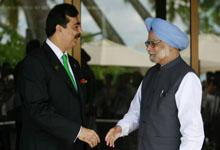 Pakistan's Prime Minister Yusuf Raza Gilani (L) and his Indian counterpart Manmohan Singh prepare to shake hands before the 17th South Asian Association for Regional Cooperation (SAARC) summit, at the Shangri-La in Addu November 10, 2011.  REUTERS/Dinuka Liyanawatte
