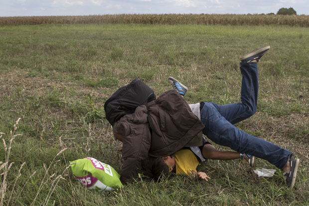 SLIDESHOW: Migrants tripped up