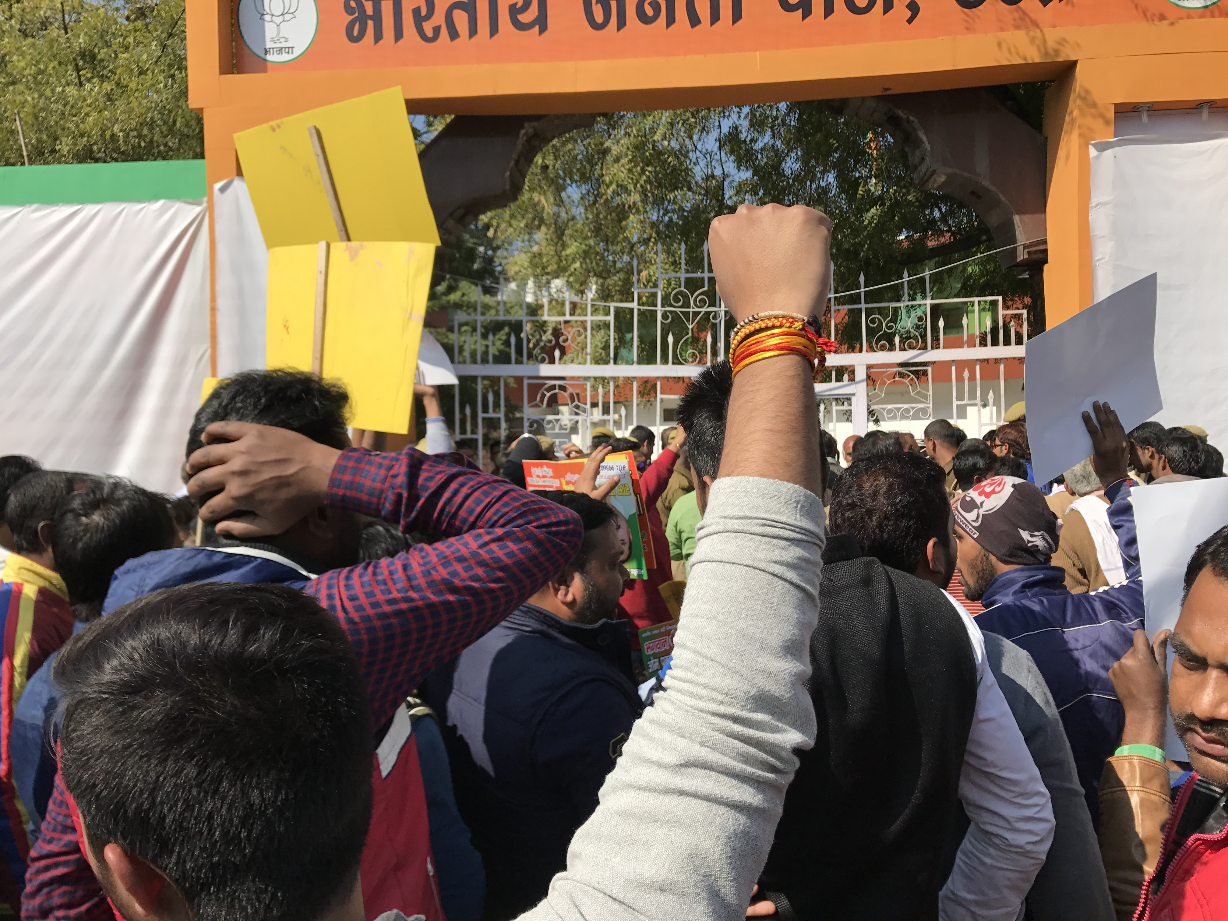 BJP supporters protesting outside the party headquarters in Lucknow.