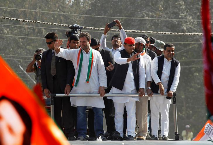 Rahul Gandhi (L), Vice-President of India's main opposition Congress Party, and Akhilesh Yadav, Samajwadi Party (SP) President and Chief Minister of the northern state of Uttar Pradesh, wave to the crowd during a road show ahead of the fourth phase of state assembly polls, in Allahabad, India, February 21, 2017. REUTERS/Jitendra Prakash