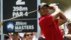 photo  Tiger Woods of the U.S. tees off on the second hole during the final round of the Australian Masters golf tournament in Melbourne November 15, 2009. REUTERS/Mick Tsikas