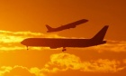 Passenger planes land and take off at Sydney airport April 28, 2009. REUTERS/Tim Wimborne 