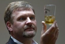 Jeff Arnett, master distiller at the Jack Daniel's distillery, looks at a glass of whiskey as he poses during an interview with Reuters in Paris September 9, 2010.