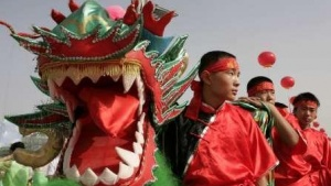 Participants wait to perform a dragon dance during a mass fitness programme outside the National Stadium, also known as the Bird's Nest, in Beijing June 20, 2009.