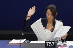 Italy's Member of the European Parliament Licia Ronzulli takes part with her baby in a voting session at the European Parliament in Strasbourg September 22, 2010. REUTERS/Vincent Kessler