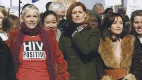 Activist and author Sarah Brown (centre) is shown with musician Annie Lennox (R) on the 2010 International Women's Day. REUTERS/Women for Women International bridge march