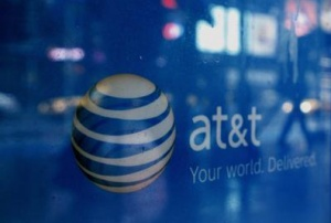 Reflections are seen in the window of an AT&amp;T store in New York March 21, 2011. REUTERS/Brendan McDermid