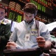 A trader looks at his screen in the crude oil and natural gas options pit on the floor of the New York Mercantile Exchange March 7, 2011. REUTERS/Lucas Jackson