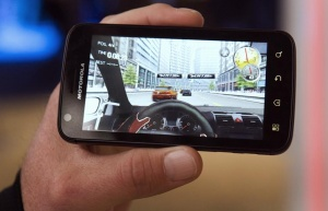A demonstrator plays a racing game on an Android-based Motorola Atrix smartphone during the Consumer Electronics Show (CES) in Las Vegas January 6, 2011. REUTERS/Steve Marcus
