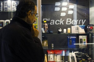 A man looks at a BlackBerry product display in a shop at a mobile and computer shopping complex in northern Tehran January 18, 2011. REUTERS/Raheb Homavandi 