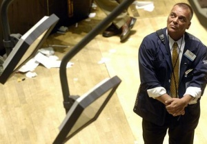A stock trader looks towards a computer screen on the floor of the New York Stock Exchange REUTERS/Chip East