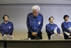 Tokyo Electric Power Company, Inc. (TEPCO) Vice President Sakae Muto (C) bows at a news conference at the company head office in Tokyo March 28, 2011. REUTERS/Toru Hanai