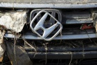 A Honda logo on a car is seen at Sendai airport which was damaged by the March 11 earthquake and tsunami, in Natori, Miyagi Prefecture April 1, 2011. REUTERS/Toru Hanai 