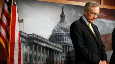 Senate Majority Leader Harry Reid looks down after talking about the budget in the Capitol in Washington April 7, 2011. The U.S. Congress on Thursday neared a budget deal to avert a looming government shutdown but disputes over abortion and environmental issues posed late hurdles to a final agreement. REUTERS/Kevin Lamarque