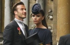 Soccer star David Beckham and his wife Victoria arrive at Westminster Abbey before the wedding of Britain's Prince William and Kate Middleton, in central London April 29, 2011. REUTERS/Kai Pfaffenbach
