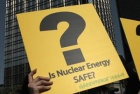 Anti-nuclear protesters hold signs at a rally organized by Greenpeace to demand the government immediately stop the expansion of nuclear power offered by mainland China in Hong Kong April 24, 2011. REUTERS/Tyrone Siu 