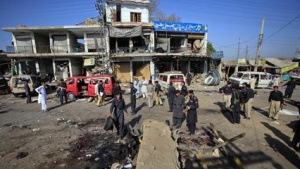 Paramilitary forces investigate at the site of a suicide bomb blast in Charsadda, northwest Pakistan May 13, 2011. REUTERS/Fayaz Aziz