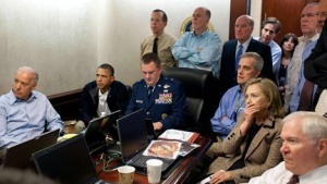 President Barack Obama (2nd L) and Vice President Joe Biden (L), along with members of the national security team, receive an update on the mission against Osama bin Laden in the Situation Room of the White House, May 1, 2011. Also pictured are Secretary of State Hillary Clinton (2nd R) and Defense Secretary Robert Gates (R). Please note: A classified document seen in this photograph has been obscured at source. REUTERS/White House/Pete Souza/Handout
