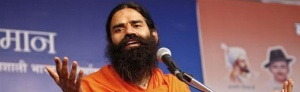 Yoga guru Swami Ramdev speaks during a yoga camp in Haridwar April 8, 2010. REUTERS/Jitendra Prakash/Files