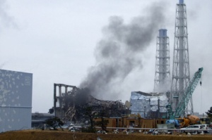 Smoke is seen coming from the area of the No. 3 reactor of the Fukushima Daiichi nuclear power plant in Tomioka, Fukushima Prefecture in northeastern Japan in this handout photo distributed by the Tokyo Electric Power Co. on March 21, 2011.   REUTERS/Tokyo Electric Power Co.