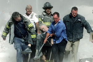 Rescue workers carry mortally injured New York City Fire Department chaplain, the Rev. Mychal Judge, from the wreckage of the World Trade Center in New York City September 11, 2001. The Chaplain was crushed to death by falling debris while giving a man last rites in the trade center. REUTERS/Shannon Stapleton