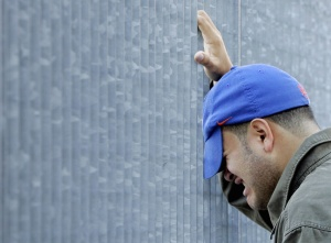 A man grieves outside the World Trade Center site in New York September 11, 2006.    REUTERS/Shannon Stapleton