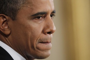 President Barack Obama pauses during a news conference at the White House in Washington, October 6, 2011.   REUTERS/Jason Reed