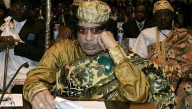 Libyan leader and the new chairman of the African Union, Muammar Gaddafi, listens in during the opening session of the 12th African Union Summit in Ethiopia's capital Addis Ababa, February 2, 2009.  REUTERS/Antony Njuguna