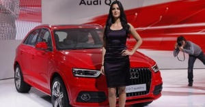 Bollywood actress Katrina Kaif poses with Audi's new SUV Q3 car during Delhi Auto Expo, in New Delhi January 5, 2012.  REUTERS/Adnan Abidi