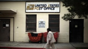 Betty Terry walks past a post office which closed its counter services four years ago at the Veterans Administration in Los Angeles, California, January 30, 2012. REUTERS/Lucy Nicholson