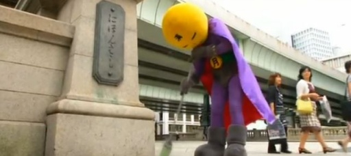 Masked superhero sweeps clean