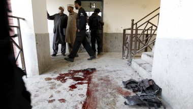 Blood stains and flak jackets used by attackers remain in the hallway of a dormitory where a militant attack took place, at Bacha Khan University in Charsadda, Pakistan January 20, 2016. REUTERS/Caren Firouz