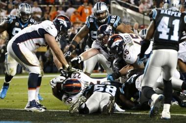Denver Broncos' C.J. Anderson scores a touchdown in the fourth quarter. REUTERS/Lucy Nicholson