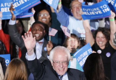 Democratic presidential candidate Bernie Sanders waves after winning at his 2016 New Hampshire presidential primary night rally in Concord, New Hampshire February 9, 2016. REUTERS/Rick Wilking