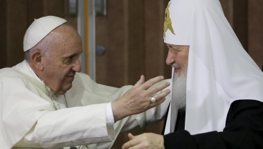 Pope Francis, left, reaches to embrace Russian Orthodox Patriarch Kirill after signing a joint declaration at the Jose Marti International airport in Havana, Cuba, Friday, February 12, 2016. REUTERS/Gregorio Borgia/Pool