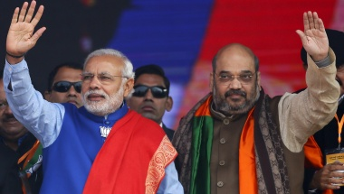 File photo of Indian PM Modi and Shah, president of BJP, waving to supporters during a campaign rally ahead of state assembly elections in New Delhi