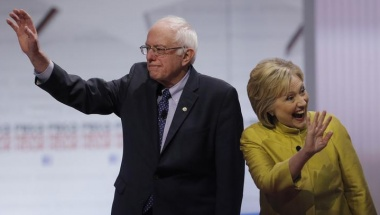 Democratic presidential candidates Senator Bernie Sanders, former Secretary of State Hillary Clinton wave as they arrive on stage before of the start of the PBS NewsHour Democratic debate in Milwaukee, Wisconsin, February 11, 2016. REUTERS/Jim Young