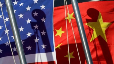 National flags of the U.S. and China are seen in front of an international hotel in Beijing January 17, 2011. REUTERS/Jason Lee
