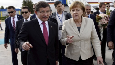 Turkish Prime Minister Ahmet Davutoglu welcomes German Chancellor Angela Merkel upon her arrival at Gaziantep airport, April 23, 2016. Bundesregierung/Steffen Kugler/Handout via Reuters