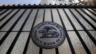 The Reserve Bank of India (RBI) seal is pictured on a gate outside the RBI headquarters in Mumbai