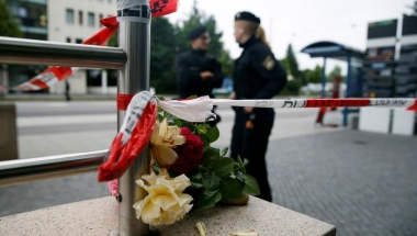 Flowers are placed near the Olympia shopping mall, where yesterday's shooting rampage started, in Munich, Germany, July 23, 2016. REUTERS/Michael Dalder