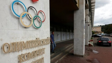 A man walks out of the Russian Olympic Committee headquarters building in Moscow
