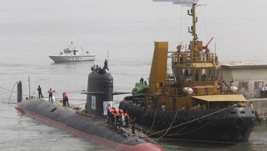 File photo of Indian Navy's Scorpene submarine INS Kalvari being escorted by tugboats as it arrives at Mazagon Docks Ltd, a naval vessel ship building yard, in Mumbai, India, October 29, 2015. REUTERS/Shailesh Andrade/Files