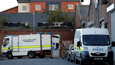 An army bomb disposal team work at the scene of an anti terrorism operation in the Lee Bank area of Birmingham
