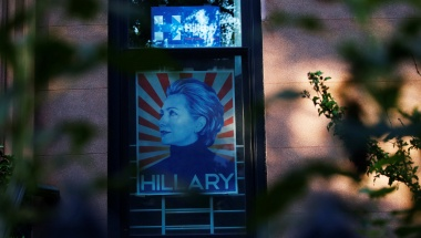 A photo of Democratic presidential candidate Hillary Clinton is seen on a window in the Carroll Gardens neighborhood of Brooklyn