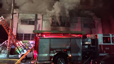 Smoke pours from a warehouse, which caught fire during a dance party in Oakland, California, U.S. December 3, 2016. Seung Lee/Handout via Reuters