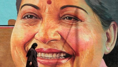 A woman walks past a portrait of J. Jayalalithaa, Chief Minister of the southern state of Tamil Nadu, in Chennai, India, March 13, 2012. REUTERS/Babu/File Photo