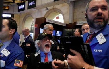 Traders work on the trading floor at the opening of the markets at the NYSE in Manhattan