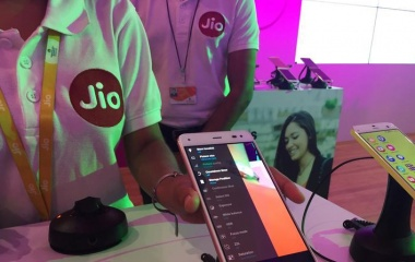 A Reliance employee demonstrates Jio LYF phone at their headquarters on the outskirts of Mumbai, India, June 1, 2016. REUTERS/Clara Ferreira Marques/File Photo