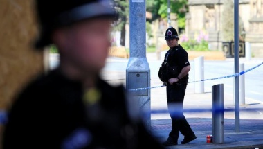 Police officers stand on duty at the cordon surrounding the Manchester Arena in Manchester, Britain, May 23, 2017. REUTERS/Jon Super
